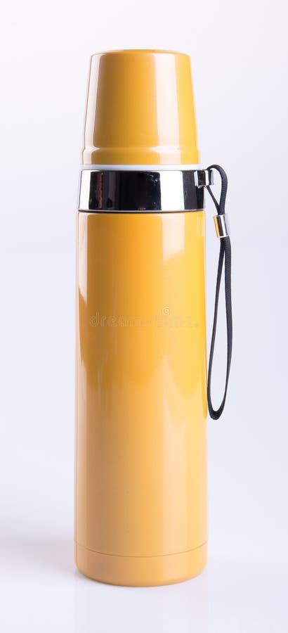 Thermo oder Thermo Flasche auf einem Hintergrund stockfotografie