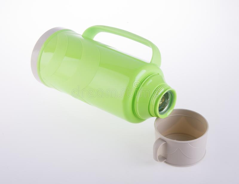 Thermo, Plastic Thermofles op achtergrond stock foto