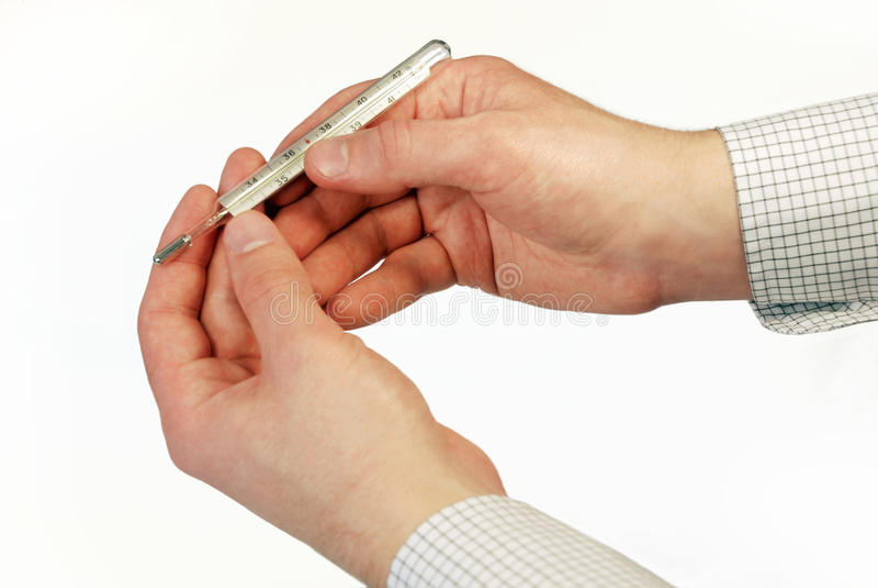 Thermometer in den Händen lizenzfreie stockfotos