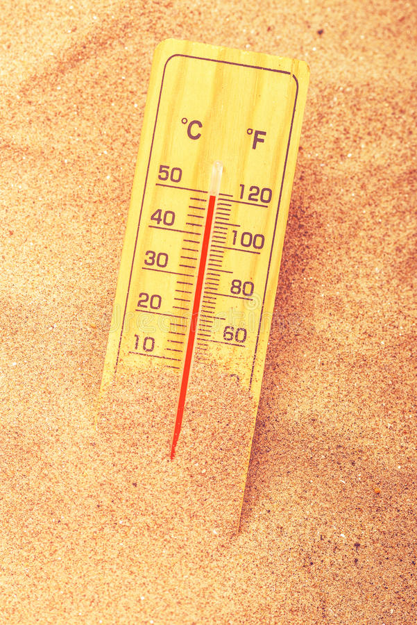 Thermometer on extreme warm desert sand stock images