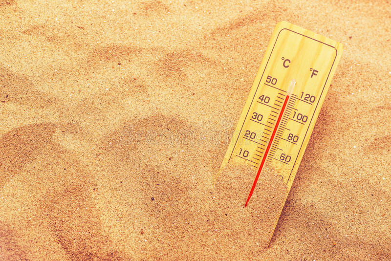 Thermometer on extremely warm desert sand stock photos
