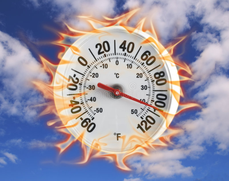 Thermometer on fire in blue sky. Round thermometer on fire shot on blue sky with clouds royalty free stock images