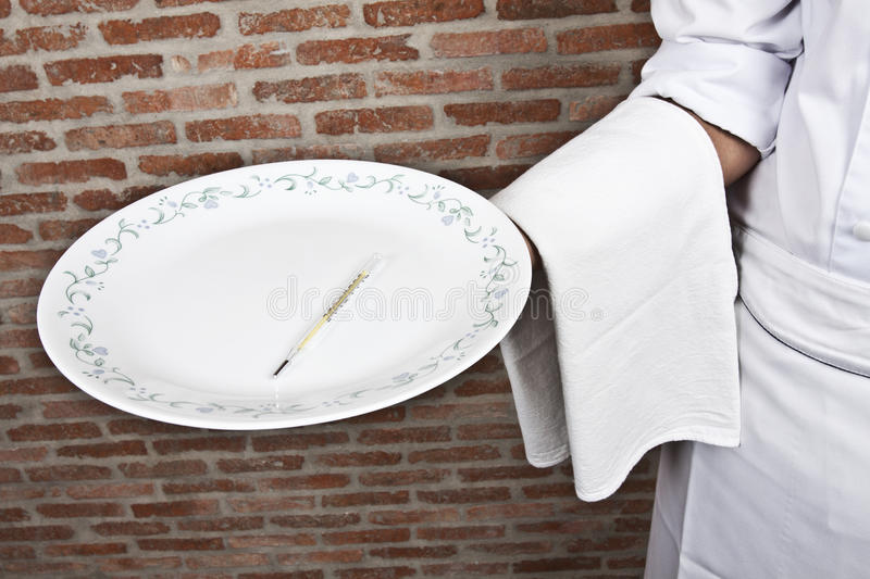 Thermometer on serving dish royalty free stock photo