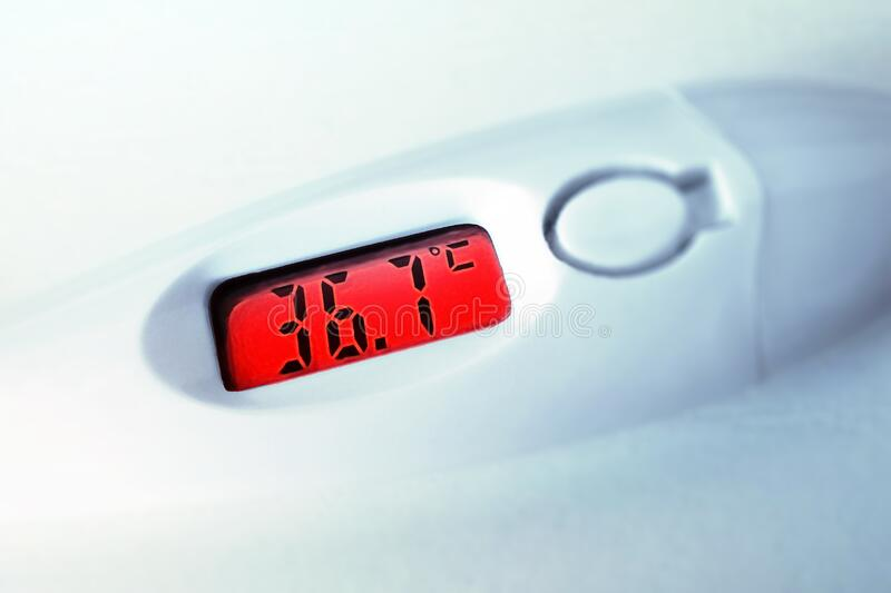 Thermometer showing fever 37.1. Health care. Red fever celsius electronic medical thermometer closeup on red background. Thermometer showing fever 37.1. Red royalty free stock photos