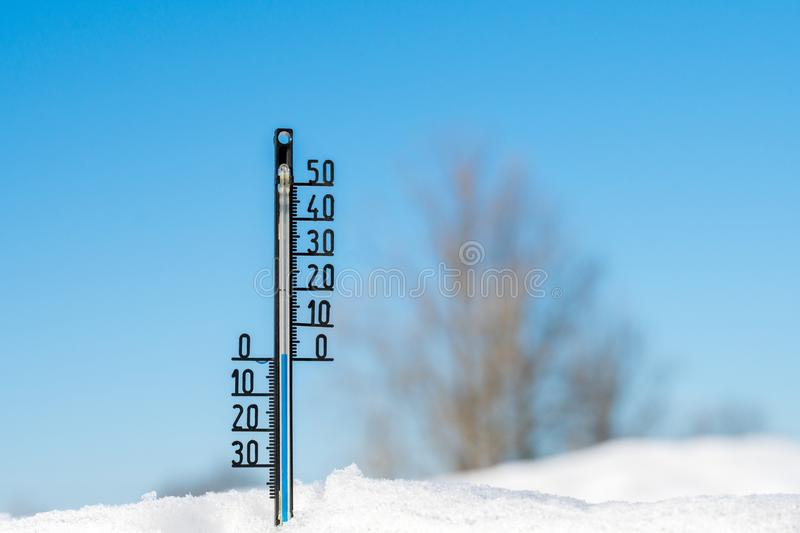 Thermometer shows zero temperatures royalty free stock photography