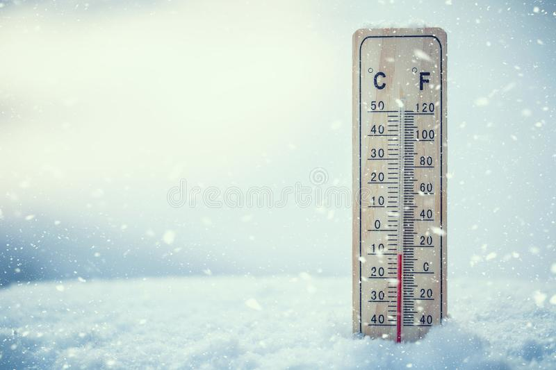 Thermometer on snow shows low temperatures under zero. Low tempe stock photo