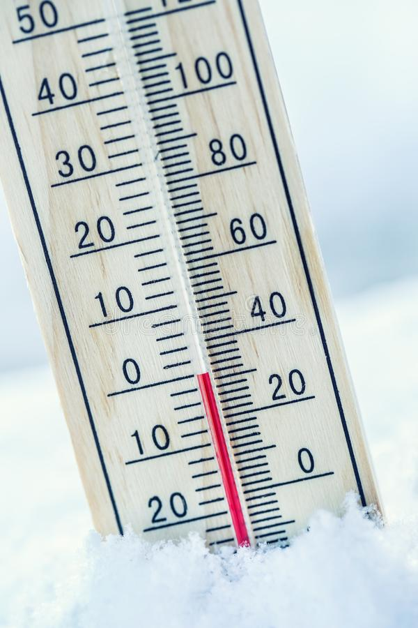Thermometer on snow shows low temperatures zero. Low temperature royalty free stock photography