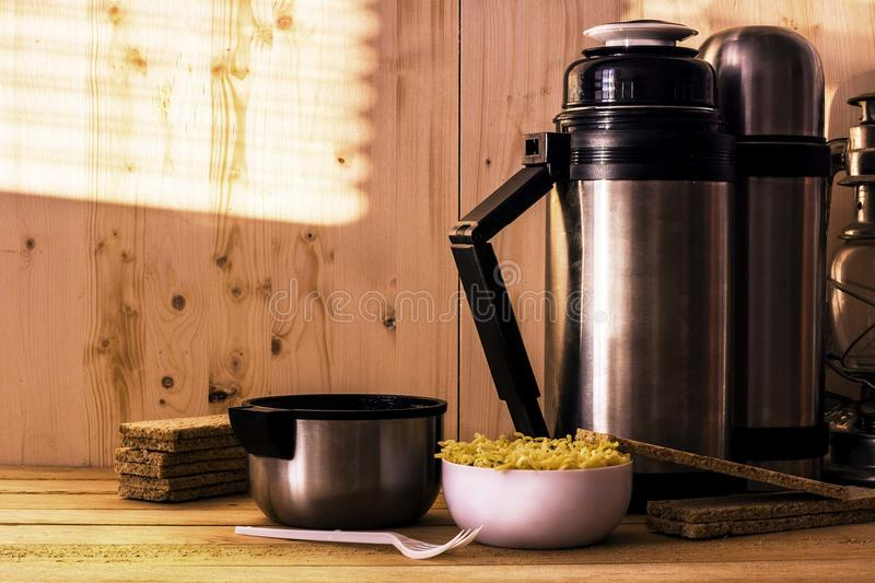 Thermos and instant noodles stock image