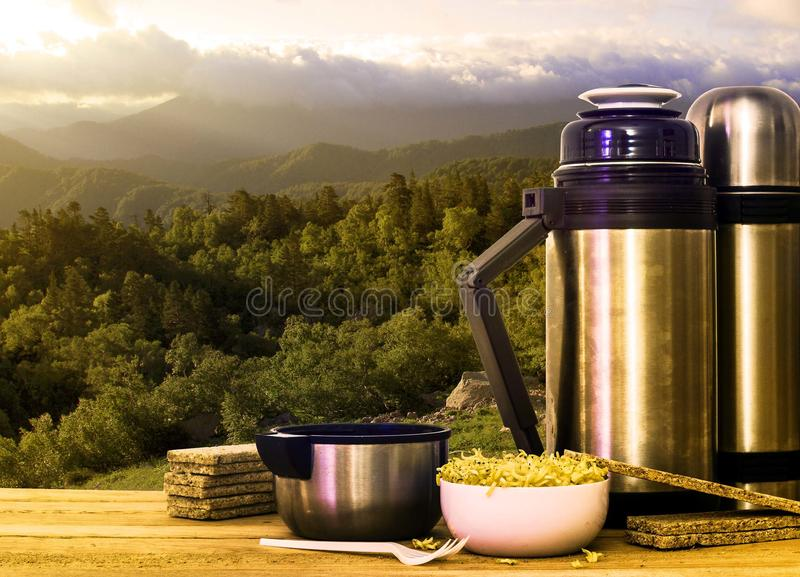 Thermos and instant noodles in the mountains stock photos
