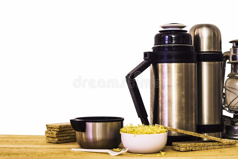 Thermos and instant noodles and wooden background royalty free stock photography
