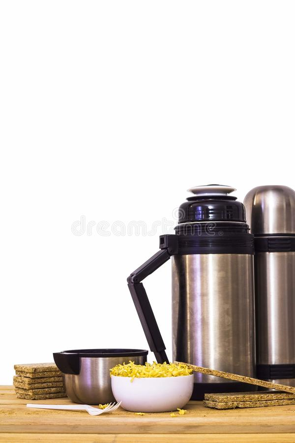 Thermos and instant noodles and wooden background stock photos