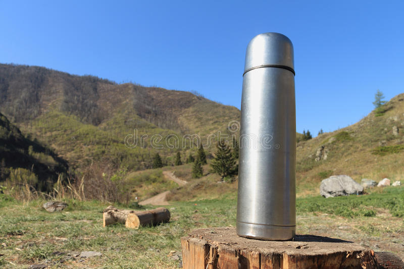 Thermos. The metal thermos is on a stub on a glade stock image