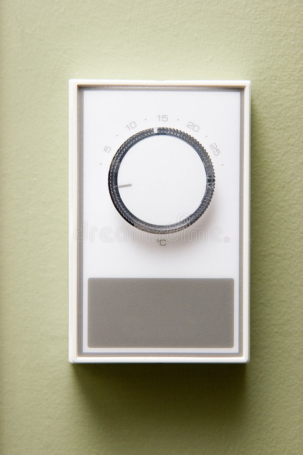 Thermostat. Typical electric baseboard heater thermostat stock photos