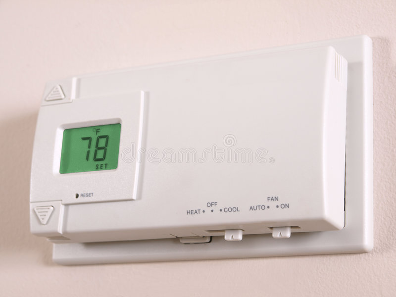Thermostat 78 F angle view. Wall Thermostat set at 78 degrees Farenheit angle view royalty free stock images