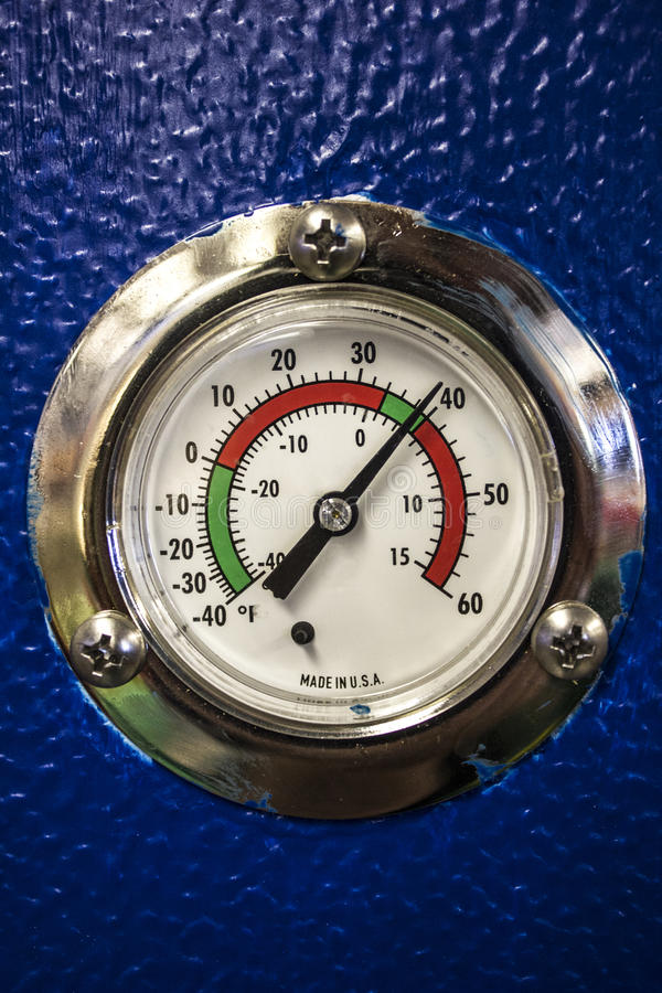 Thermostat dial in degrees Farenheit for a Commercial Refrigerator. Temperature thermostat dial or gauge of a commercial refrigerator for the food & beverage royalty free stock photo