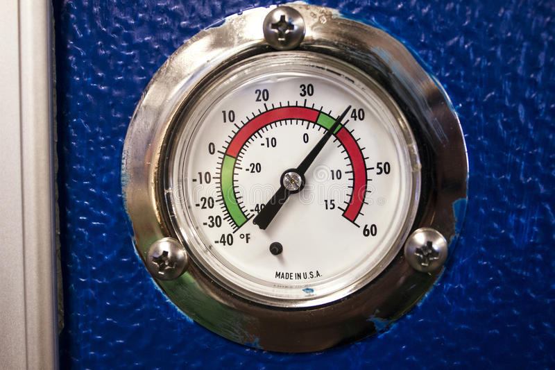 Thermostat dial in degrees Farenheit for a Commercial Refrigerator. Temperature thermostat dial or gauge of a commercial refrigerator for the food & beverage stock photo