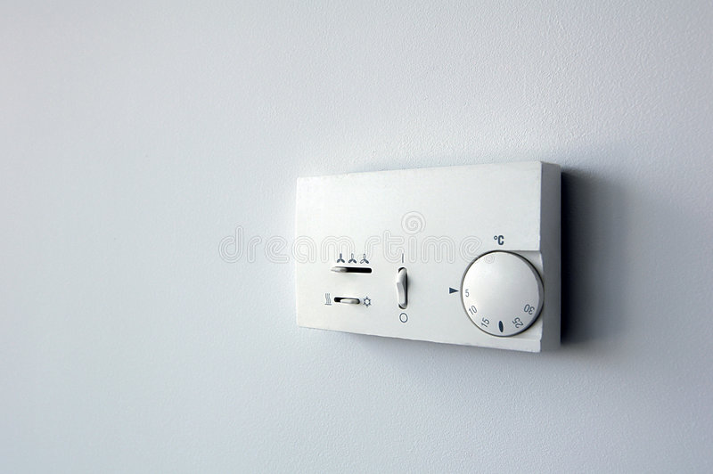 Thermostat with fan and temperature control royalty free stock photography