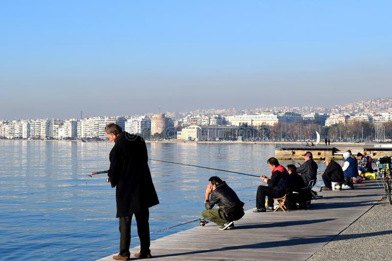 Thessaloniki, Greece - December 28 2015: Fishermen in Thessaloniki seafront, Greece. royalty free stock photography