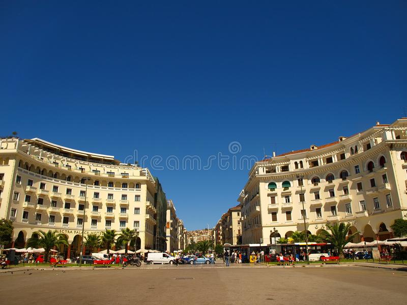 Thessaloniki, Greece - Pedestrians and traffic in Aristotelous Square. Thessaloniki, Greece - Pedestrians and traffic at Aristotelous Square stock photography