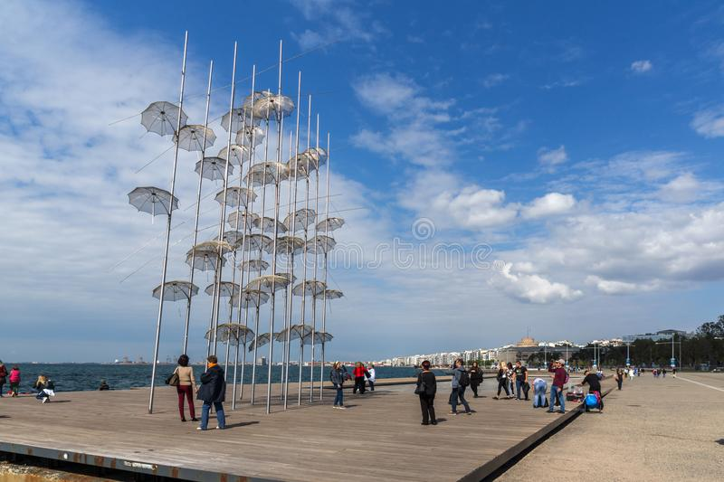 People under Umbrellas sculpture in of of city of Thessaloniki, Central Macedonia, Gre royalty free stock photography