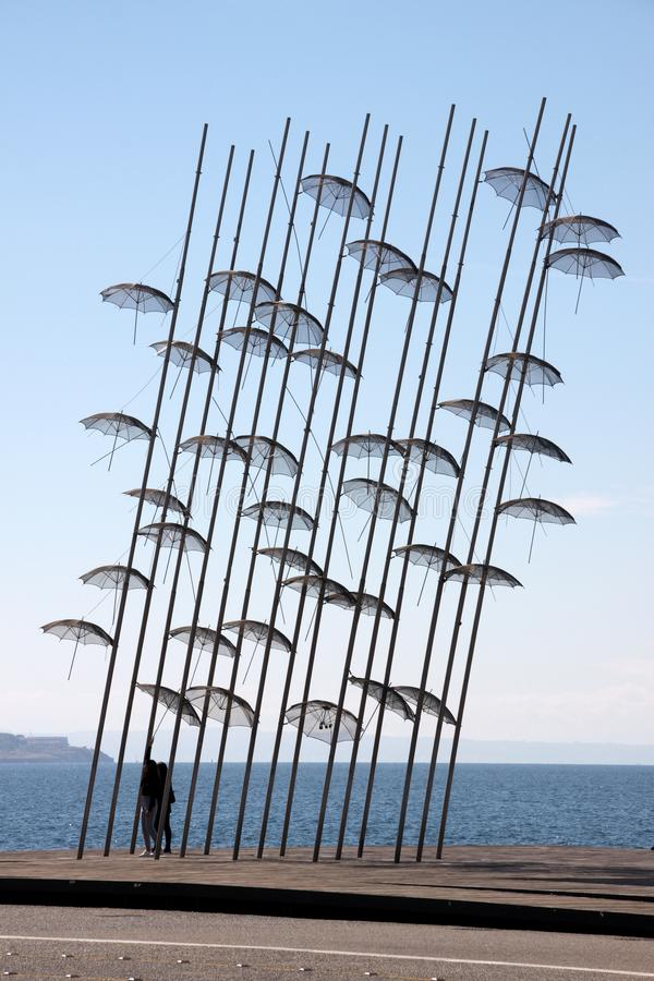 THESSALONIKI, GREECE - SEPTEMBER 1, 2018: People passing by the umbrellas of Thessaloniki stock photos