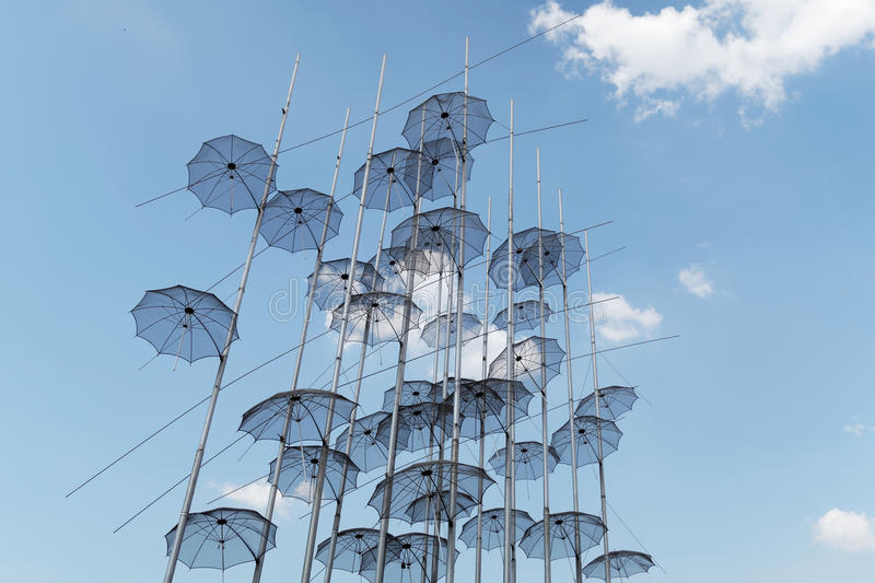 Thessaloniki, Greece - September 04 2016: Umbrellas art at Thessaloniki seafront. This work created by artist George Zongolopoulos was installed to be seen free royalty free stock image