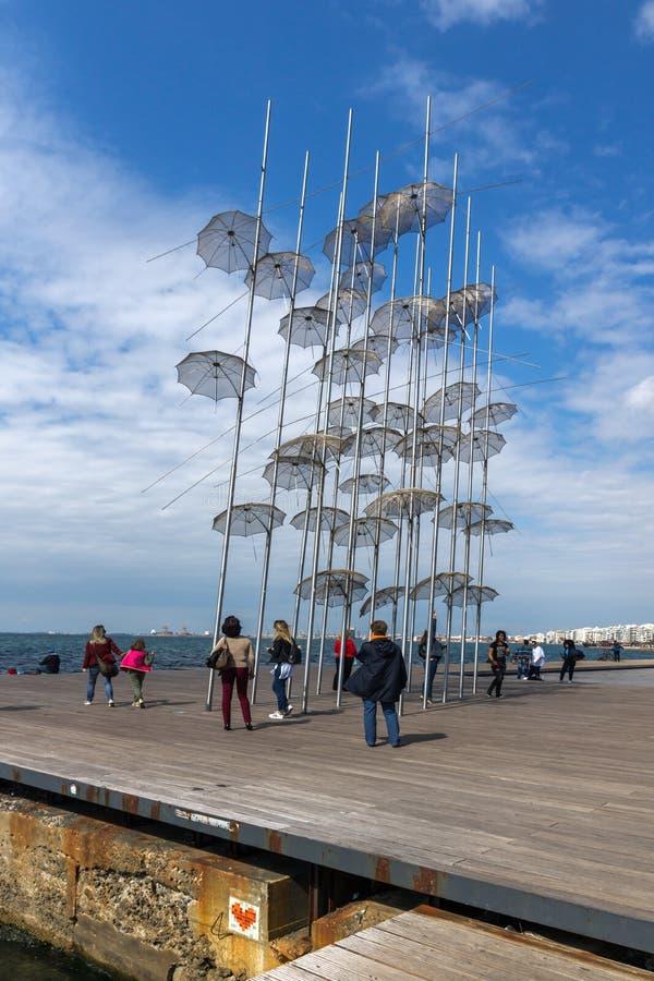 Umbrellas sculpture at Coastal street in city of Thessaloniki, Central Macedonia, Greec. THESSALONIKI, GREECE - SEPTEMBER 30, 2017: Umbrellas sculpture at royalty free stock photo