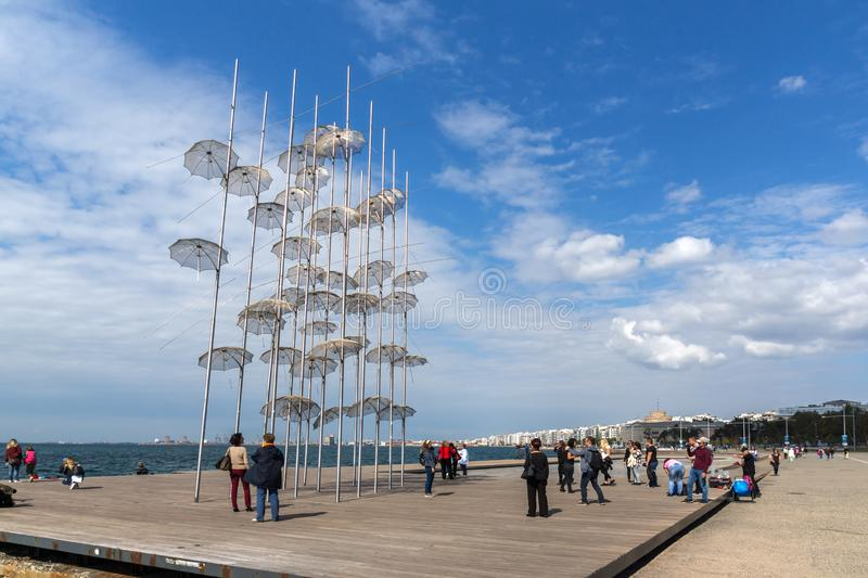 Umbrellas sculpture at Coastal street in city of Thessaloniki, Central Macedonia, Greec. THESSALONIKI, GREECE - SEPTEMBER 30, 2017: Umbrellas sculpture at stock photography