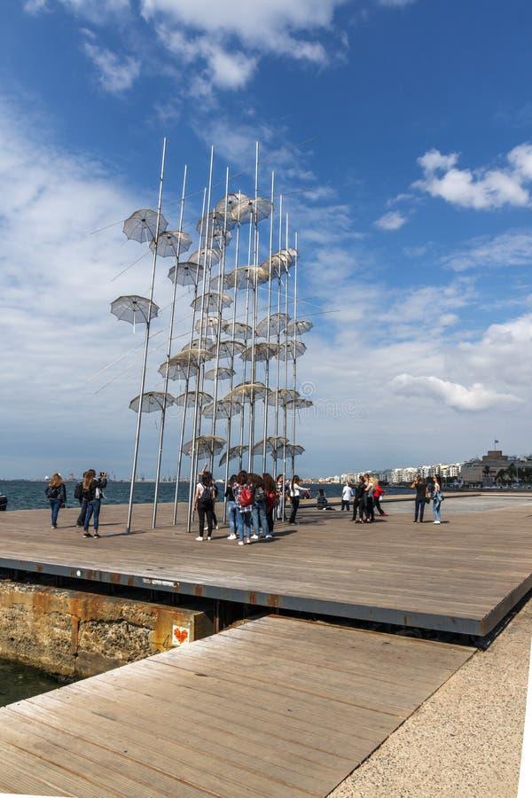 Umbrellas sculpture at Coastal street in city of Thessaloniki, Central Macedonia, Greec. THESSALONIKI, GREECE - SEPTEMBER 30, 2017: Umbrellas sculpture at stock photo