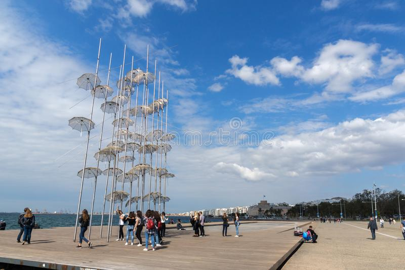 Umbrellas sculpture at Coastal street in city of Thessaloniki, Central Macedonia, Greec. THESSALONIKI, GREECE - SEPTEMBER 30, 2017: Umbrellas sculpture at royalty free stock photography