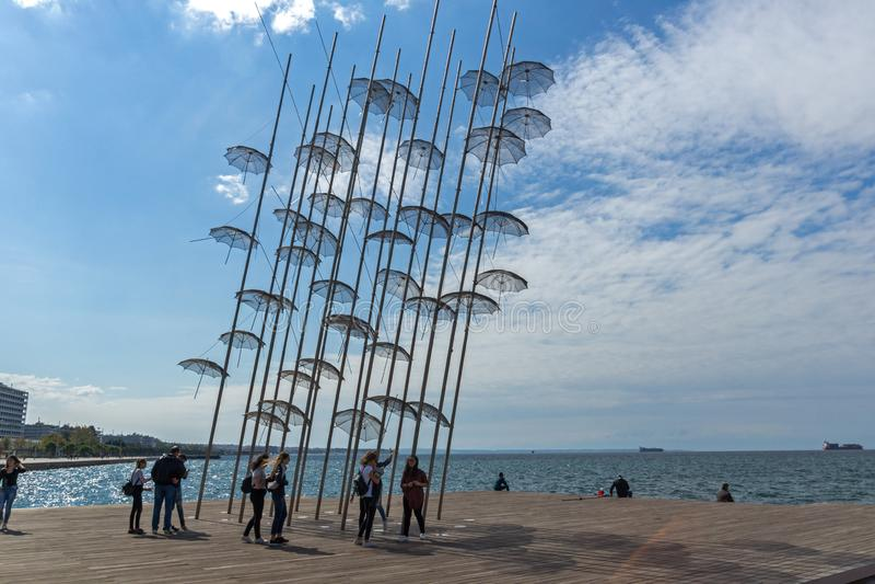 Umbrellas sculpture at Coastal street in city of Thessaloniki, Central Macedonia, Greec. THESSALONIKI, GREECE - SEPTEMBER 30, 2017: Umbrellas sculpture at stock photos