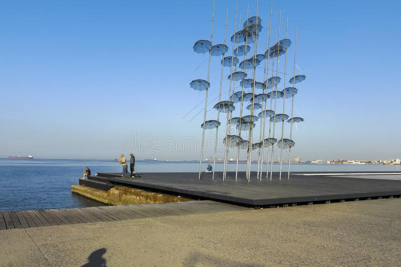 Umbrellas sculpture in Thessaloniki, Greece. THESSALONIKI, GREECE - SEPTEMBER 22, 2019: Umbrellas sculpture at embankment of city of Thessaloniki, Central royalty free stock photo