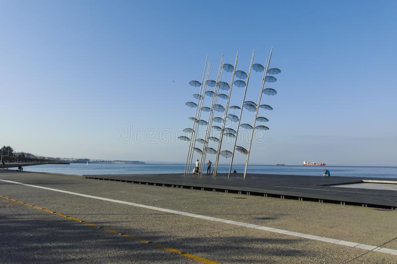 Umbrellas sculpture in Thessaloniki, Greece. THESSALONIKI, GREECE - SEPTEMBER 22, 2019: Umbrellas sculpture at embankment of city of Thessaloniki, Central stock photography