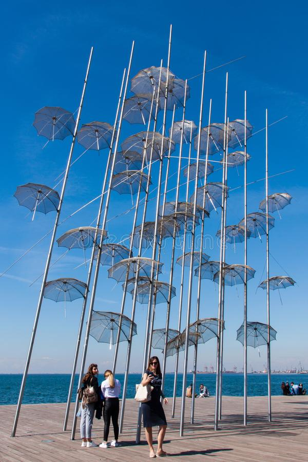 THESSALONIKI, GREECE - SEPTEMBER 1, 2018: People passing by the umbrellas of Thessaloniki stock images