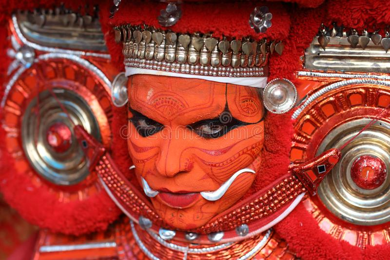 Theyyam dancer in Kannur, India. A dancer at a traditional Theyyam ceremony in a temple in Kannur, India. Theyyam is Kerala`s most popular ritualistic art form stock image