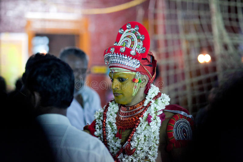 Theyyam Ritual in Kerala, South India. KANNUR, INDIA - JANUARY 15, 2016: Indian priest conducts Theyyam ceremony at Arathil Bhagavathi Temple in Kannur, South stock images