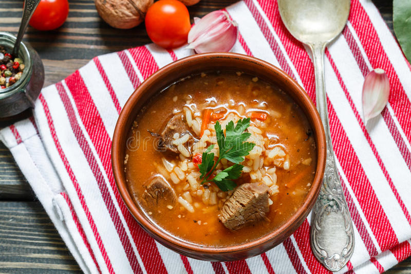 Thick beef soup with rice, tomatoes, carrots, peppers, walnuts and spices. Kharcho soup. A traditional dish of Georgian cuisine. royalty free stock images