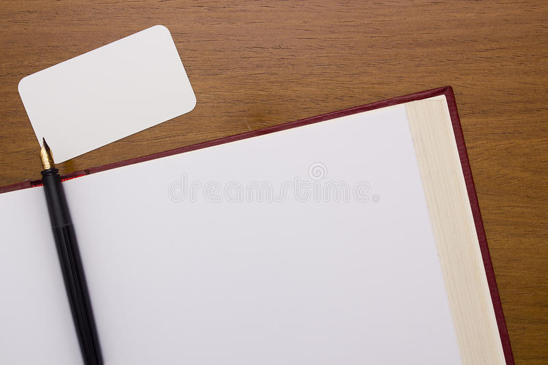 Thick book with a clean slate. And a blank business card stock photography