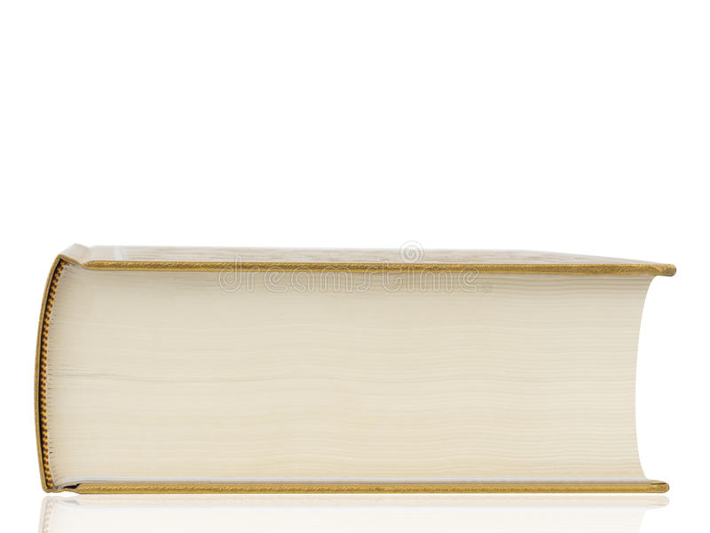 Thick book with gold cover isolated on white background. Clipping path stock image