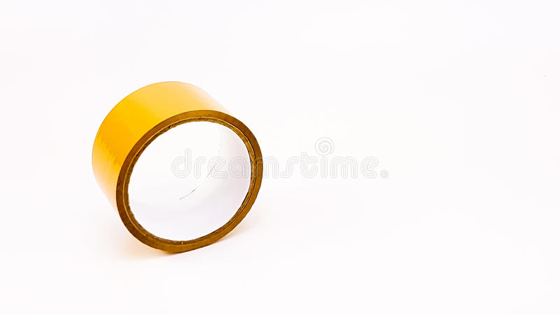 Thick brown plastic tape in white big core. Isolated stock photos