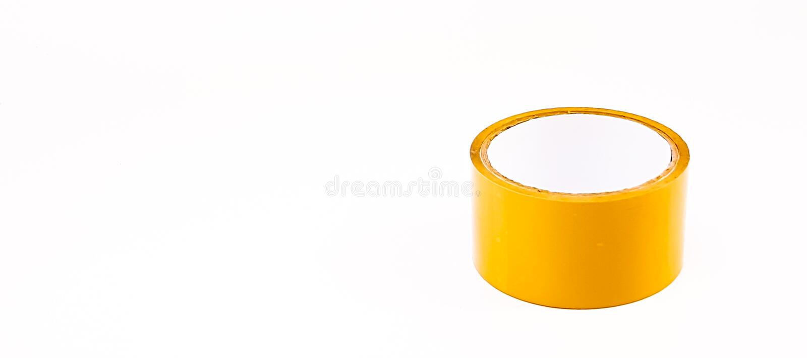 Thick brown plastic tape in white big core. Isolated royalty free stock photo
