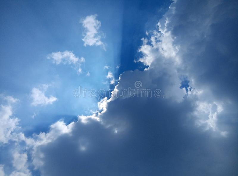 Thick clouds, blue sky and sunlight covered in clouds.  The atmosphere of the sky during the day. Air, beauty, beautiful, white, bright, climate, extreme royalty free stock photography