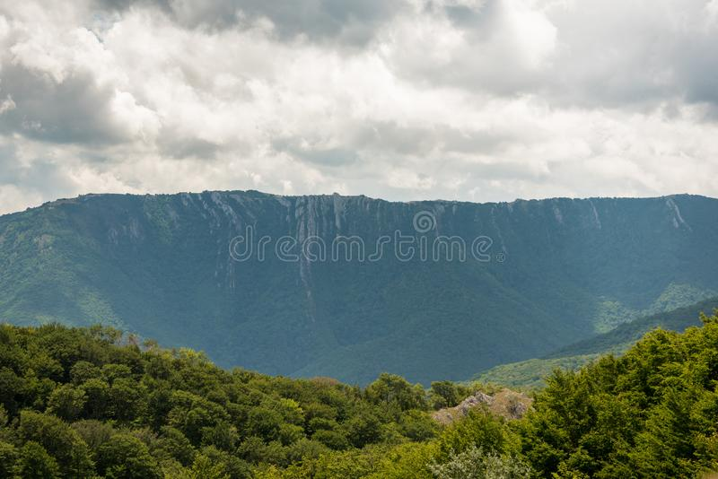 Thick clouds over mountain range royalty free stock photo