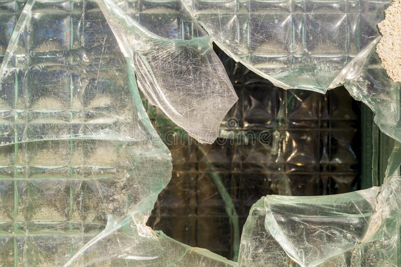 The thick, cracked glass of a window. The thick glass partition. Glass wall background. Glass texture and surface royalty free stock photos