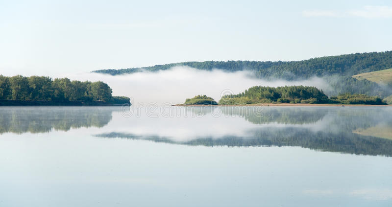 Download Thick fog stock photo. Image of island, still, tree, hill - 12537536