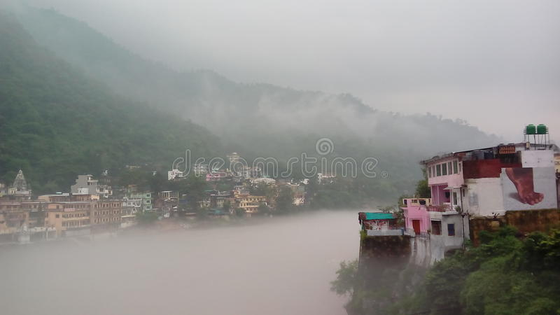 Thick fog over Ganges River in Rishikesh stock images