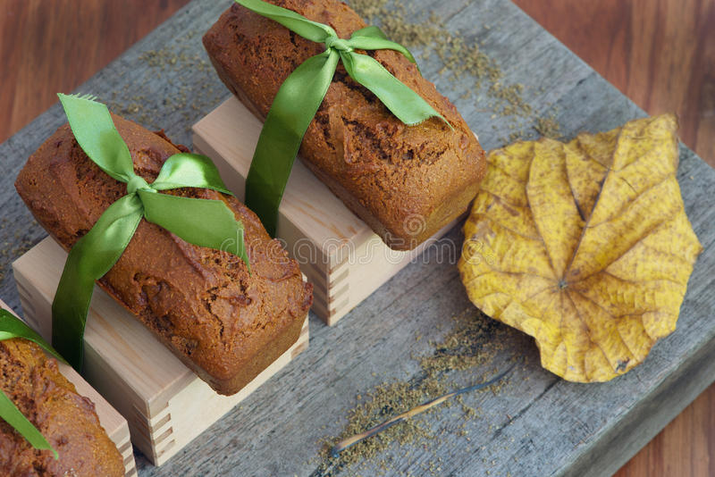 Thick gingerbread. French thick gingerbread also called pain d'epices, on rustic board spices and autumn leaf stock photography