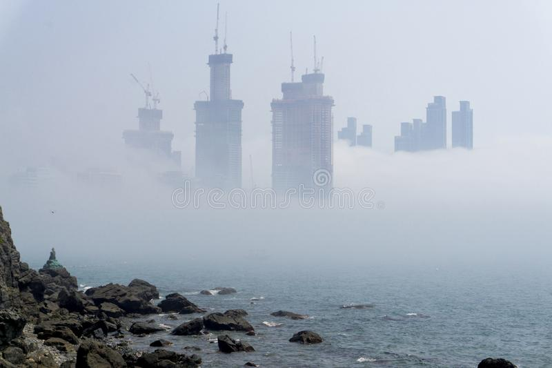 Thick large and heavy mist blow from the sea to the land and pas stock images