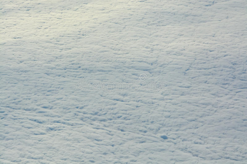 Thick layer of clouds seen from a plane. Over European sky royalty free stock photography