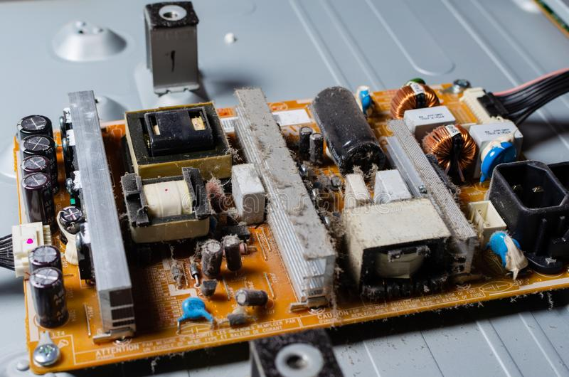 A thick layer of dust covers the internal electronic components of the computer stock image